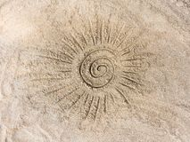 The sun on the sand. Sun drawn by finger on the sand Royalty Free Stock Photography
