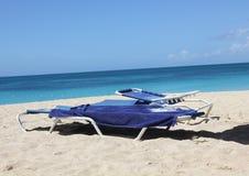 Sun sand and sea Antigua Turners beach. Su loungers on a Caribbean beach Stock Images