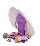 Sun, Sand, & Surf. Floppy white sun hat, flip flops, and seashells isolated on a white background. A day at the beach royalty free stock photos