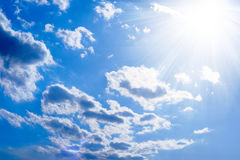 The sun and scattered clouds Royalty Free Stock Images