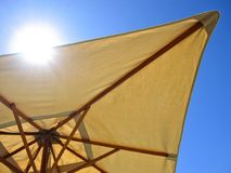 Sun Scream!. Landscape photo of an umbrella blocking out the sun royalty free stock photography