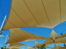 Sun screens. A roof of sunscreens shaped like sails Royalty Free Stock Image