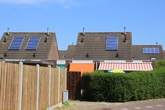 Solar panels on the roof of the houses in the summer. stock photography