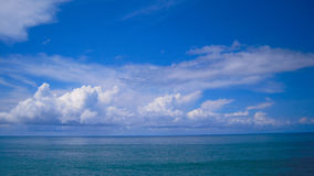 Sun sea cloud. The sun shineing the sea, and cloud in the sky Stock Images