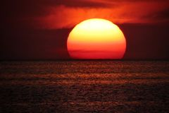 Sun on sea horizon. Sunset view, Sun on sea horizon royalty free stock image