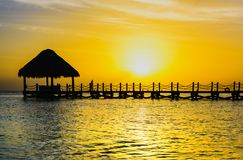 Sun sea tropical sunset view of the pier of the caribbean Royalty Free Stock Images