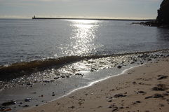 Sun on the sea at tynemouth haven Stock Photography