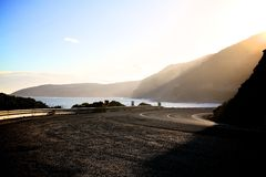 Sun set. The mountain, the ocean , the road and the sun set Royalty Free Stock Photo