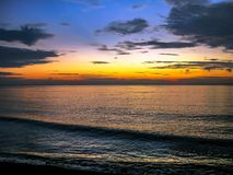 Sun set at the Bali Beach. A very beautiful sunset at Bali beach, Indonesia with blue clouds sky and horizon orange color background stock photography