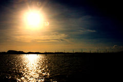 Sun set in dark sky on sea. Sun set in dark sky on sea Royalty Free Stock Photos