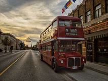 Sun set double decker bus. A double decker bus stop in a sunset time Royalty Free Stock Photo