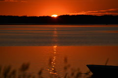 Sun set on the fjord. Sun set with orange colours on the fjord Stock Image