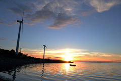 Sun set at the fjord. Sun setting in a fjord in Denmark close the windmills Royalty Free Stock Image