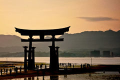 Sun set and holy gate  Torii  at Miyajima islands Stock Photos