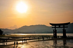 Sun set and holy gate  Torii  at Miyajima islands Royalty Free Stock Photo