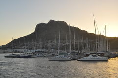 Sun set at houtbay. This photo was taken at houtbay during sunset.Houtbay is situated at the coast of cape town.This part of cape got beautiful mountains and Royalty Free Stock Photography