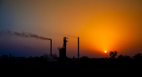 Sun set in industrial area Royalty Free Stock Photo
