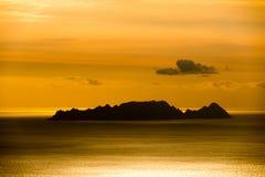 Sun set and island Stock Photography