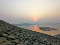 Sun set on Mangla Dam stock image