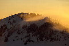 Sun set in mountains with winter and cold scenery Royalty Free Stock Photo