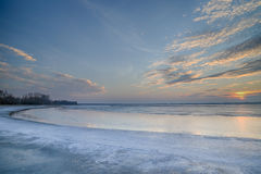 The sun set over the frozen lake Stock Image