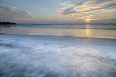 The sun set over the frozen lake Royalty Free Stock Image