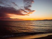 Sun set over the horizon - beautiful empty beach - small waves stock photos