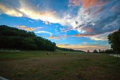 Sun set over horse camp Stock Photo