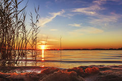The sun set over Lake Liepāja. The sun set over the lake in the beautiful Royalty Free Stock Image