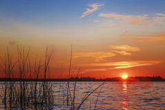 The sun set over Lake Liepāja. The sun set over the lake in the beautiful Stock Photography
