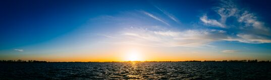 Sun set over lake panorama royalty free stock image