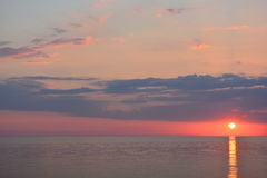 Sun set over the ocean. The sun setting over the ocean Royalty Free Stock Images