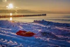 The sun set over the sea. As the sun set over the sea`s sled Stock Photography