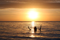Sun Set Philippines. Sun set in the Philippines. Woman silhouette in the sun set royalty free stock photography