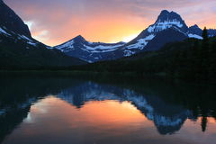 Swift Current Lake at Sunset Glacier National Park. The sun set reflects off the calm waters of Swift Current Lake in the Many Glacier region of Glacier National Royalty Free Stock Images