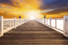 Sun set scene and old wood bridge pier with nobody against beaut Stock Images
