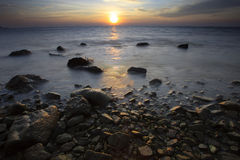 Sun set on sea scape Stock Photography