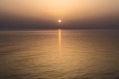 Sun set at sea Stock Photos