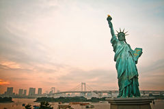 Sun set and Statue of liberty in Japan Stock Photos