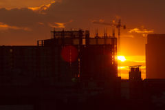 Sun set under construction Stock Images