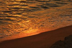 Sun set with water and sand ,Gall-face, Sri lanka, stock photo