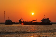 Sun set with water and sand ,Gall-face, Sri lanka, royalty free stock photo