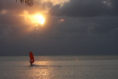 Sun set windsurf. Windsurfing with a beautiful sun set and clouds Royalty Free Stock Photo