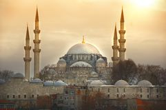 The sun sets above the Suleymaniye Mosque in Istanbul. The sun sets above the impressive Suleymaniye Mosque. one the most famous architectural achievements of royalty free stock images