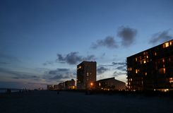 Sun sets behind the beach vacation boardwalk Royalty Free Stock Photography