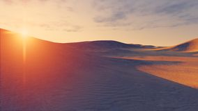 Sun sets behind the desert dunes Royalty Free Stock Photo