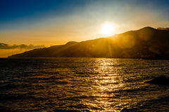The sun sets behind the mountain Royalty Free Stock Images