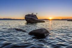 Sun burst over Bonsai Rock royalty free stock image