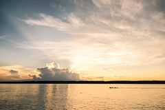 A sunset at the Javari River with boar passing by royalty free stock photography
