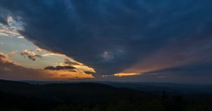 Diagonal clouds at sunset viewing from a lookout tower royalty free stock image